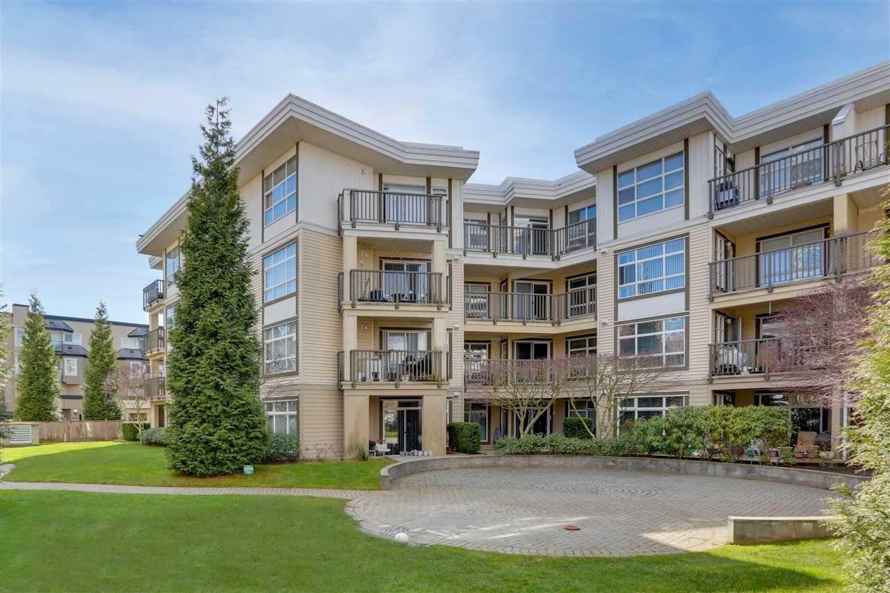 "Main Photo: 111 15168 19 Avenue in Surrey: Sunnyside Park Surrey Condo for sale in ""MINT"" (South Surrey White Rock)  : MLS®# R2558156"