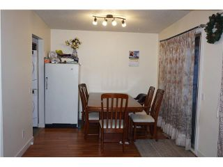 Photo 4: 1825 46 Street SE in Calgary: Forest Lawn Residential Attached for sale : MLS®# C3648866