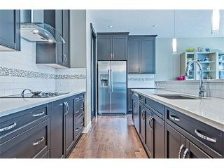 Photo 5: 14 ROCKFORD Road NW in Calgary: Rocky Ridge House for sale : MLS®# C4048682