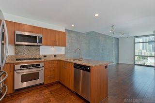 Photo 1: DOWNTOWN Condo for rent : 1 bedrooms : 800 The Mark Ln #1002 in San Diego