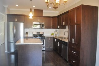 """Photo 14: 6854 208 Street in Langley: Willoughby Heights Condo for sale in """"Milner Heights"""" : MLS®# R2603848"""