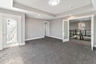 Photo 32: 211 Kinniburgh Place: Chestermere Detached for sale : MLS®# A1078763