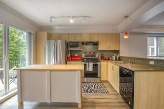"""Photo 14: 61 6747 203 Street in Langley: Willoughby Heights Townhouse for sale in """"SAGEBROOK"""" : MLS®# R2454928"""