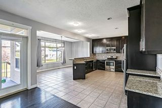 Photo 9: 121 Kinniburgh Boulevard: Chestermere Detached for sale : MLS®# A1147632