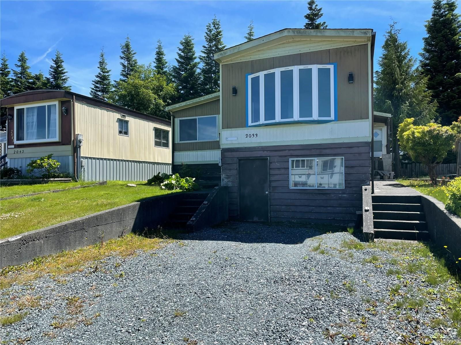 Main Photo: 2033 Chelan Cres in : NI Port McNeill Manufactured Home for sale (North Island)  : MLS®# 879552