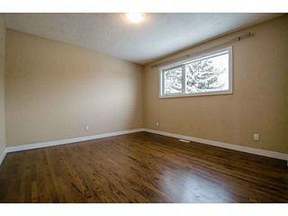 Photo 14: 1708 107 Avenue SW in Calgary: Braeside_Braesde Est Residential Detached Single Family for sale : MLS®# C3651455