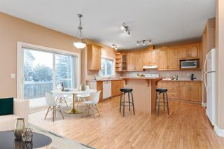 Photo 5: 7 39 Strathlea Common SW in Calgary: Strathcona Park Semi Detached for sale : MLS®# A1056254