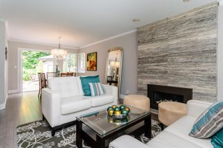 Photo 3: 23 FLAVELLE Drive in Port Moody: Barber Street House for sale : MLS®# R2599334