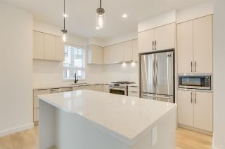 """Photo 2: 104 3021 ST GEORGE Street in Port Moody: Port Moody Centre Townhouse for sale in """"GEORGE"""" : MLS®# R2474134"""