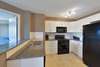 Photo 8: 2408 60 PANATELLA Street NW in Calgary: Panorama Hills Apartment for sale : MLS®# A1114606