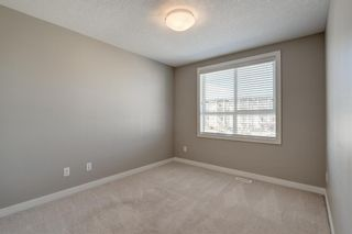 Photo 23: 103 Walgrove Cove SE in Calgary: Walden Row/Townhouse for sale : MLS®# A1145152