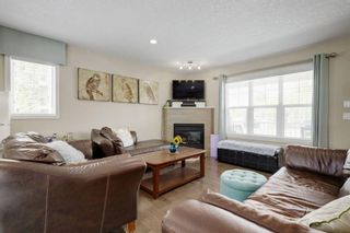 Photo 3: 203 CRANBERRY Park SE in Calgary: Cranston Row/Townhouse for sale : MLS®# A1063475