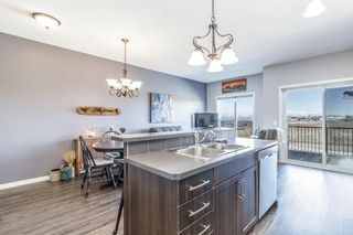 Photo 9: 603 101 SUNSET Drive: Cochrane Row/Townhouse for sale : MLS®# A1031509