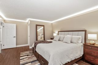 """Photo 17: 8215 STRAUSS Drive in Vancouver: Champlain Heights Townhouse for sale in """"Ashleigh Heights"""" (Vancouver East)  : MLS®# R2565596"""