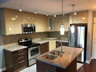 Photo 2: 322 12039 64 Avenue in Surrey: West Newton Condo for sale : MLS®# R2613884