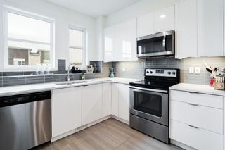Photo 13: 948 Walden Drive SE in Calgary: Walden Row/Townhouse for sale : MLS®# A1149690