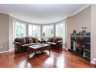 Photo 2: 7687 MARY AVE - LISTED BY SUTTON CENTRE REALTY in Burnaby: Edmonds BE House for sale (Burnaby East)  : MLS®# V1126167