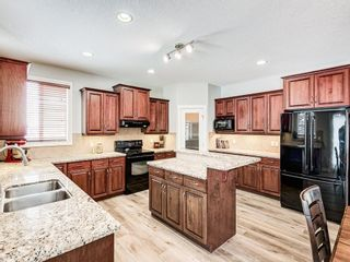 Photo 7: 26 TUSSLEWOOD View NW in Calgary: Tuscany Detached for sale : MLS®# C4296566