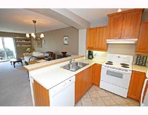 """Photo 2: Photos: 408 1438 PARKWAY Boulevard in Coquitlam: Westwood Plateau Condo for sale in """"THE MONTREUX"""" : MLS®# V733478"""