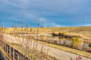 Photo 9: 504 Panatella Walk NW in Calgary: Panorama Hills Row/Townhouse for sale : MLS®# A1153133