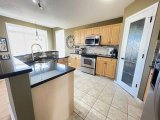 Photo 10: 80 Fairways Drive NW: Airdrie Detached for sale : MLS®# A1093153