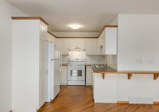 Photo 8: 44 Mt Aberdeen Manor SE in Calgary: McKenzie Lake Row/Townhouse for sale : MLS®# A1078644