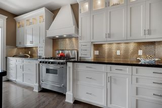 Photo 11: 976 73 Street SW in Calgary: West Springs Detached for sale : MLS®# A1125022