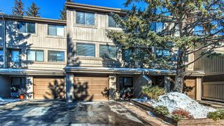 Photo 2: 22 10457 19 Street SW in Calgary: Braeside Row/Townhouse for sale : MLS®# A1074324