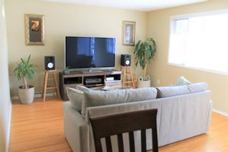 Photo 2: 708 53 Avenue SW in Calgary: Windsor Park Semi Detached for sale : MLS®# A1078390