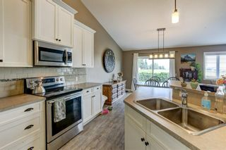 Photo 10: 26 Mackenzie Way: Carstairs Detached for sale : MLS®# A1135289