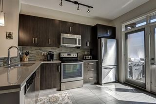 Photo 16: 13 Walden SE in Calgary: Walden Row/Townhouse for sale : MLS®# A1146775
