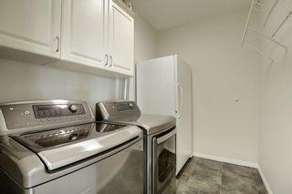 Photo 31: 1410 LAKE FRASER Green SE in Calgary: Lake Bonavista Apartment for sale : MLS®# C4294063