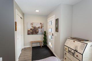 Photo 2: 179 Fireside Way: Cochrane Row/Townhouse for sale : MLS®# A1109604