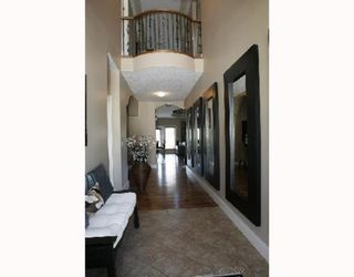 Photo 3: 25 West Cedar Point SW in Calgary: West Springs Detached for sale : MLS®# A1068967