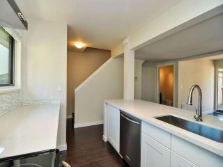 "Photo 4: 887 CUNNINGHAM Lane in Port Moody: North Shore Pt Moody Townhouse for sale in ""WOODSIDE VILLAGE"" : MLS®# V1021537"