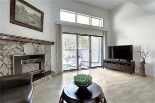 Photo 16: 24 GLAMIS Gardens SW in Calgary: Glamorgan Row/Townhouse for sale : MLS®# A1077235
