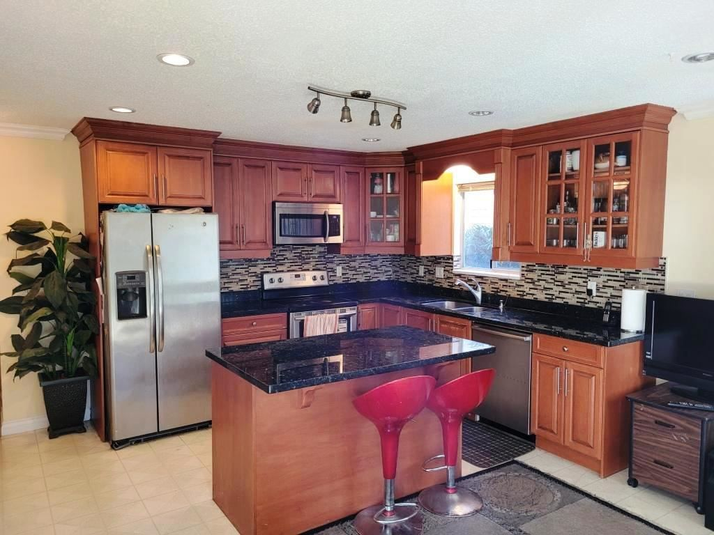 Photo 10: Photos: 8151 118A Street in Delta: Scottsdale House for sale (N. Delta)  : MLS®# R2515460