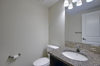 Photo 31: 2407 15 SUNSET Square: Cochrane Apartment for sale : MLS®# A1072593