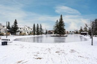Photo 1: 61 Sandpiper Lane NW in Calgary: Sandstone Valley Row/Townhouse for sale : MLS®# A1054880