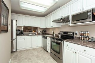 """Photo 11: 4 6537 138 Street in Surrey: East Newton Townhouse for sale in """"Charleston Green"""" : MLS®# R2303833"""