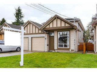 Photo 1: 7981 15TH AVE - LISTED BY SUTTON CENTRE REALTY in Burnaby: East Burnaby 1/2 Duplex for sale (Burnaby East)  : MLS®# V1113496