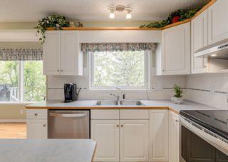 Photo 8: 115 Douglasview Bay SE in Calgary: Douglasdale/Glen Detached for sale : MLS®# A1108035