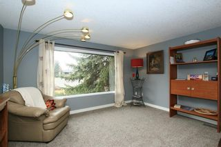 Photo 10: 30 GLENWOOD Crescent: Cochrane House for sale : MLS®# C4110589