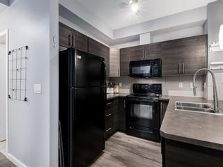 Photo 5: 213 207 SUNSET Drive: Cochrane Apartment for sale : MLS®# A1026900
