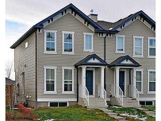 Photo 1: 99 ELGIN MEADOWS Gardens SE in CALGARY: McKenzie Towne Residential Attached for sale (Calgary)  : MLS®# C3545504