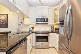 "Photo 8: 108 12655 190A Street in Pitt Meadows: Mid Meadows Condo for sale in ""Cedar Downs"" : MLS®# R2593118"