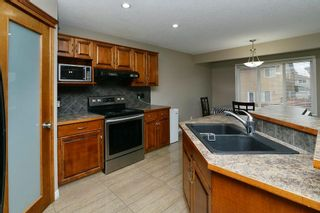 Photo 8: 151 SADDLECREST Gardens NE in Calgary: Saddle Ridge House for sale : MLS®# C4138096