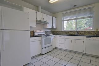 Photo 5: 835 Forest Place SE in Calgary: Forest Heights Detached for sale : MLS®# A1120545