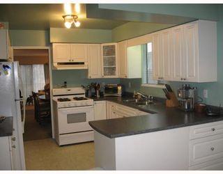 Photo 7: 5706 LANCASTER Street in Vancouver: Killarney VE House for sale (Vancouver East)  : MLS®# V810735