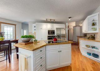 Photo 5: 143 Douglasbank Drive SE in Calgary: Douglasdale/Glen Detached for sale : MLS®# A1137861